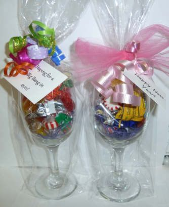 Great idea for a thank you.  Fill a wine glass with a little shred and candy. Place in a cello bag and tie off with ribbon and a note.  2 filled with chocolates and placed in a basket with a bottle of wine or Champaign is a nice gift also.