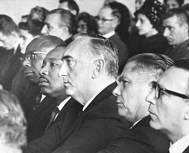 Attending rites for Viola Liuzzo in Detroit, Mich. on Mar. 30, 1965 are Dr. Martin Luther King, Jr., second from left, Harold Gibbons of St. Louis, Mo., member of the executive board of the Teamsters Union, and James Hoffa, President of the Teamsters. Othes are not identified. Mrs. Liuzzo was slain in Alabama on Mar. 25 following a march from Selma to Montgomery. (AP Photo)