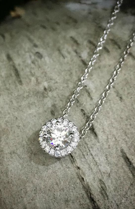 """Words to love by. """"Vitality and beauty are gifts of nature."""" - Leonardo da Vinci. Find a new way to create a polished look with a Forevermark Halo Diamond Pendant."""