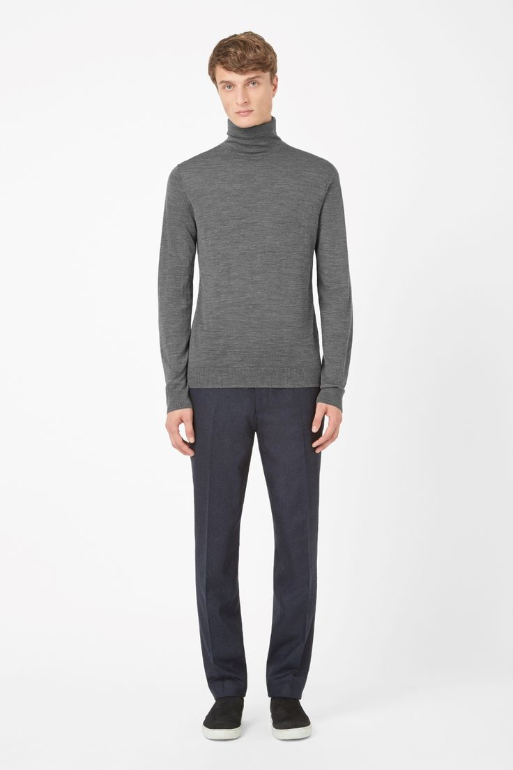 This classic roll-neck jumper is made from finely knitted merino wool with an extra-soft finish. A regular fit, it has long sleeves and neatly ribbed edges.