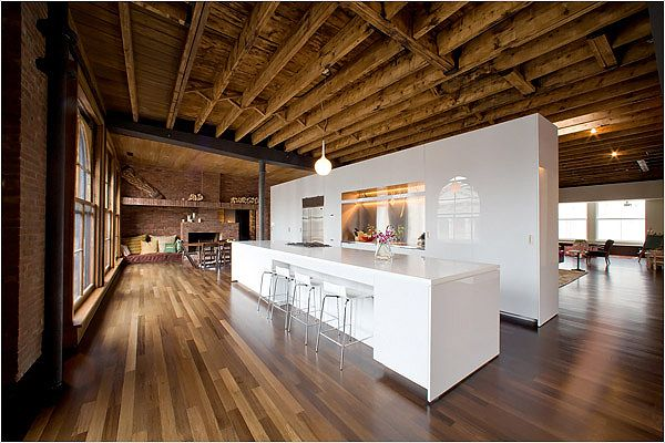 For a period of 10 months, Ms. Kashper visited the job site every day to oversee the renovation, which saw a Pop Art-inspired bachelor pad stripped down to its 19th-century shell. The Kashpers installed a freestanding kitchen in the middle of the loft.