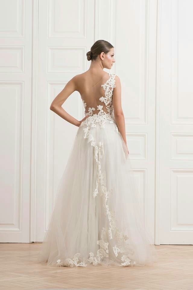 Rhea Costa - love the backless design of this wedding dress!