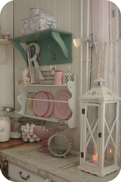 Love the lantern and the green shelf. Note to self, remember the covered box and can. Also the wire basket for eggs.