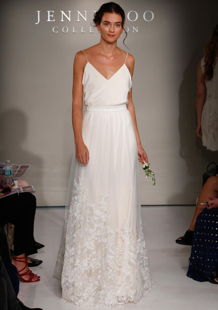 Jenny Yoo Fall 2016 wedding dress with v neckline and spaghetti straps and straight skirt with lace details on trim | https://www.theknot.com/content/jenny-yoo-wedding-dresses-bridal-fashion-week-2016
