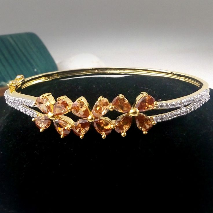 http://crazyberry.in/online-shopping/artificial-imitation-fashion-jewellery/3-flower-ad-diamond-gold-plated-bangle-bracelet-kada