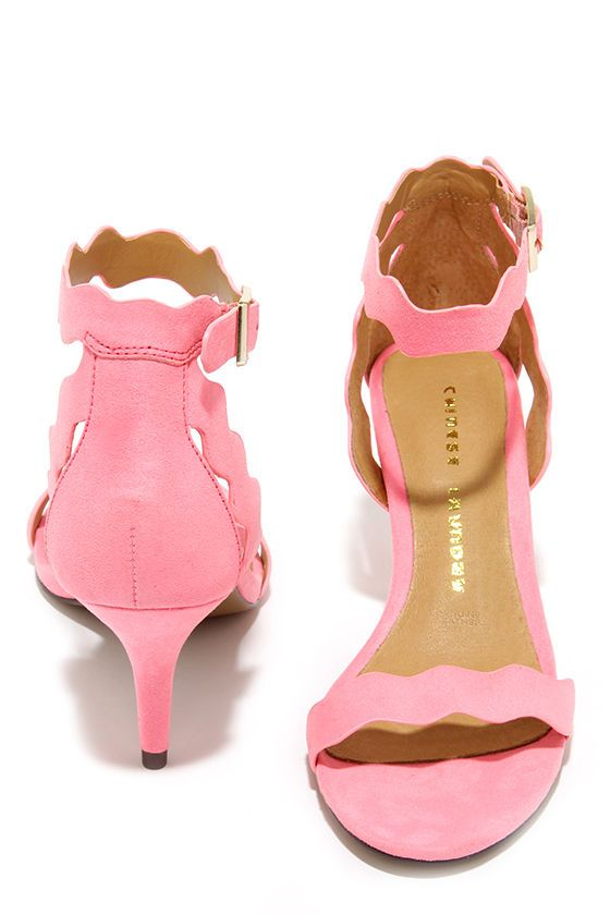 """Wave goodbye to last year's heels, and wave in the Chinese Laundry Rubie Pink Kitten Heels! These gorgeous microfiber suede heels have a scalloped hot pink upper with a peep toe, and adjustable ankle strap. Elegant 2.75"""" kitten heels are perfect for dancing all night. Cushioned insole. Nonskid rubber sole. Available in whole and half sizes. Measurements are for a size 6. Leather lining. Balance man made materials."""