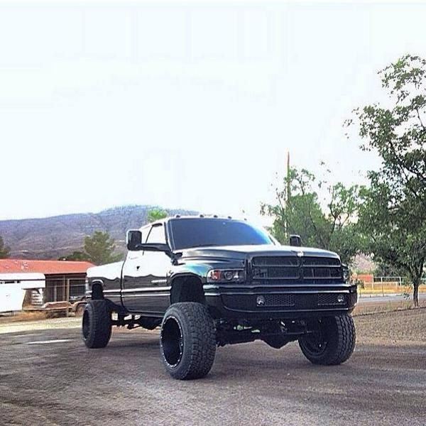 Black Lifted Dodge  Ram truck nice tires