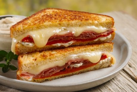 Stacked with prosciutto, melted mozzarella cheese and red peppers, this simple sandwich will surely hit the spot.