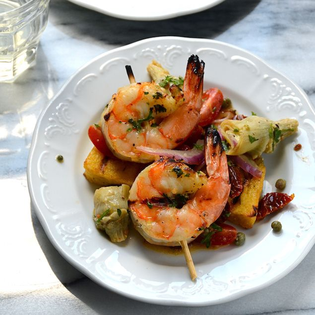 Grill Like an Italian with Colavita: Grilled Shrimp and Polenta: Set polenta is grilled and topped with tangy dressed vegetables, sun-dried tomatoes, and succulent marinated and grilled shrimp.