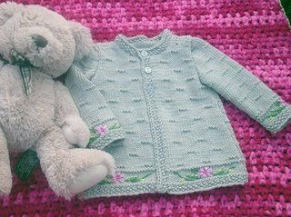 """Pattern description from Vogue Knitting, Spring/Summer 2007: """"'I designed this sweater nine years ago, when I was expecting my second baby, my first and only girl. I loved the idea of a very feminine, classic baby-girl sweater done in a tine gauge and in washable wool. I'm happy for the chance to recreate it in luxury fiber so I can share it with expectant mothers and with grandmothers who want to make a special heirloom gift. This time I hose a slightly chunkier yarn to make the stitchi..."""