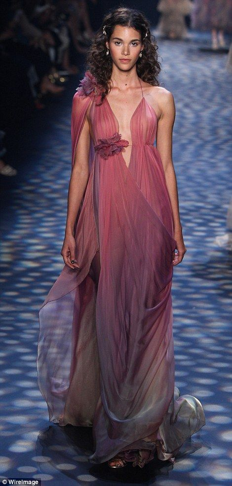 The team: Makeup was done by Bobbi Brown, nail designs were by Zoya, and hair was done by ...Marchesa  Spring 2017 collection