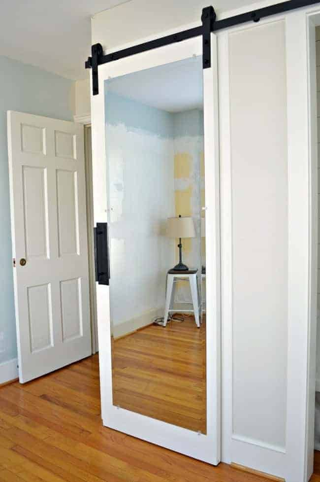 How To Make A Diy Mirrored Barn Door Out Of An Old Door For A Guest Bedroom Closet Cheap Barn Doors Diy Closet Doors Door Mirror Diy