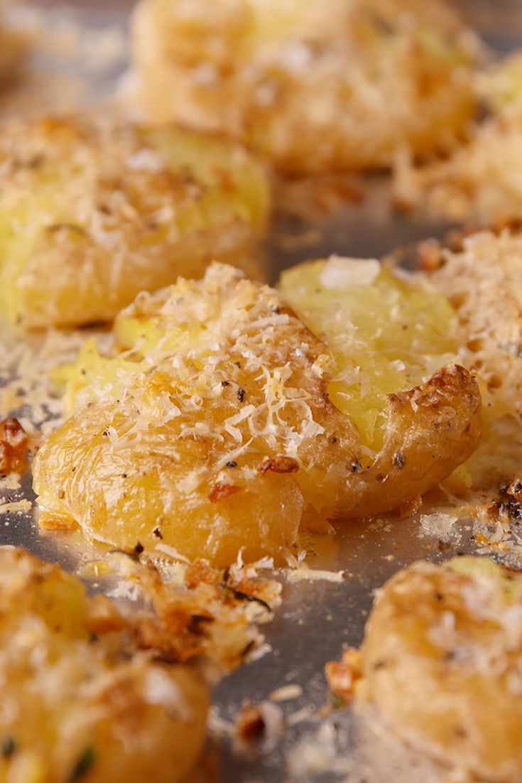 Garlic Smashed Potatoes are the new tater tots. Parmesan cheese is your secret weapon with these bad boys. http://www.delish.com/cooking/recipe-ideas/recipes/a49007/garlic-smashed-potatoes-recipe/