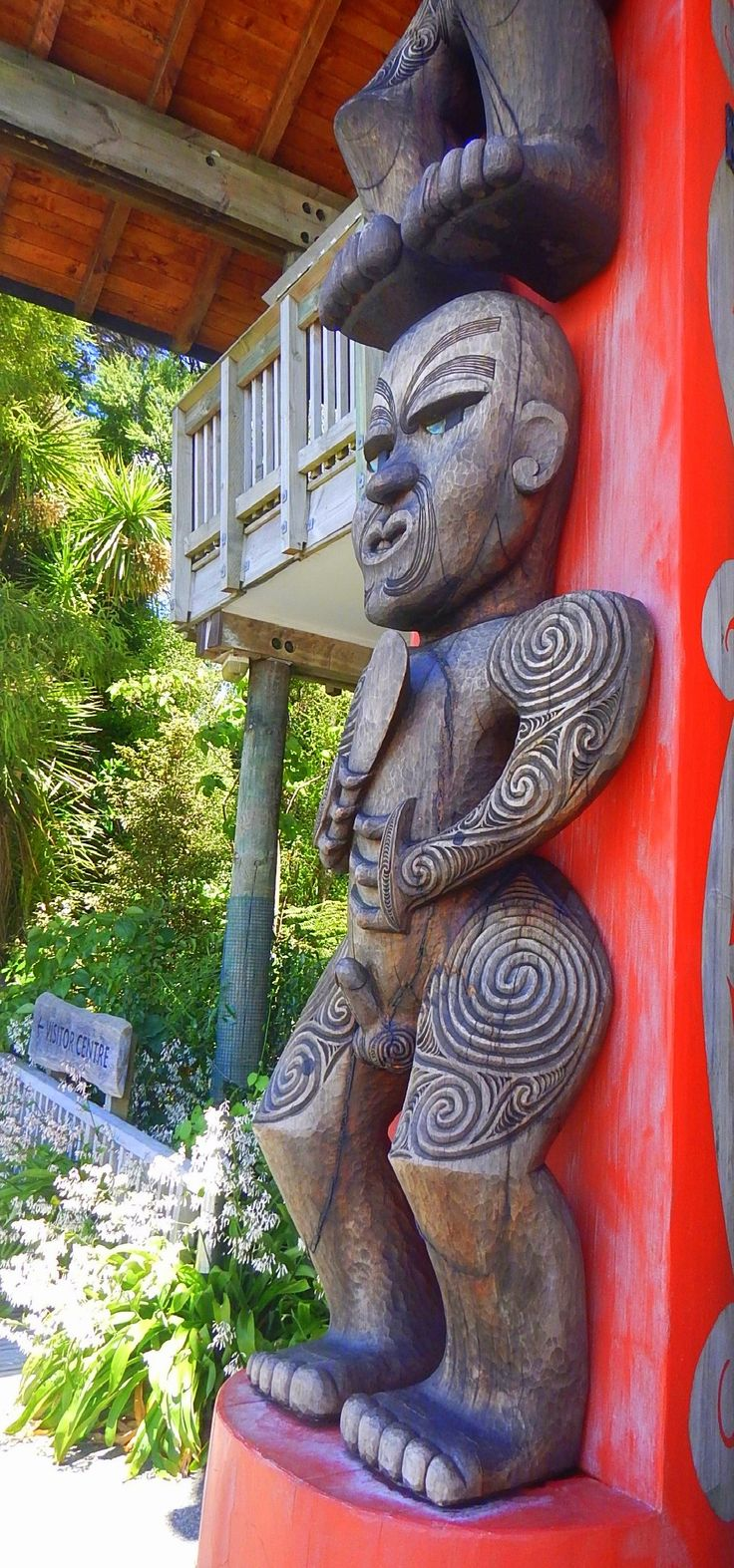 Maori carving on a pou (guardian post) at Arataki Visitor Centre in the Waitakere Ranges Regional Park, Auckland, NZ