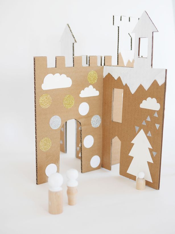 Make this Easy WInter Cardboard Castle to celebrate the holidays with your little ones! It's a fun craft for the whole family, and it even makes fun décor when not in use!