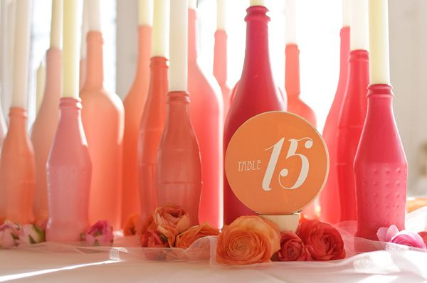 Spray painted bottles of various sizes, shapes and shades of pink. TheKnotWedding.com shot by RusticWhitePhotography.comIdeas, Candle Holders, Candles Holders, Sprays Painting Bottle, Painted Bottles, Wedding Colors, Tables Numbers, Wine Bottle, Centerpieces
