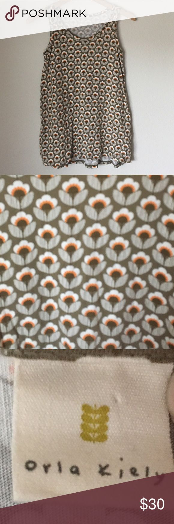 Orla Kiely Uniqlo Brown Floral Tank Top Size Small Orla Kiely Uniqlo brown floral tank top, size small.  Cotton/modal Blend.  Brown with white and orange flowers. Orla Kiely x Uniqlo Tops Tank Tops