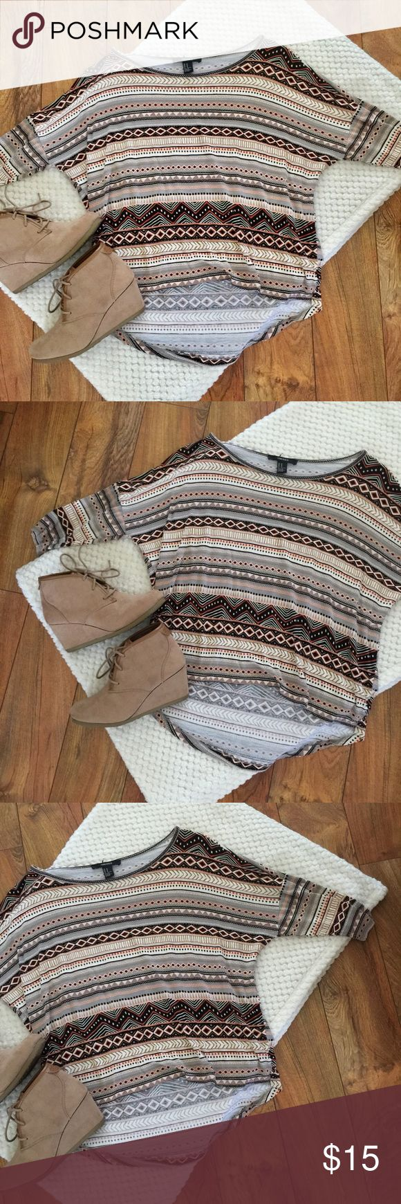 FOREVER 21 • Batwing High Low Aztec FOREVER 21 • Batwing High Low. Good used condition. Size medium. Measurements: Flat Bust 25.5 inches Length in front 20.5 inches Length in back 25.5 inches Forever 21 Tops Blouses