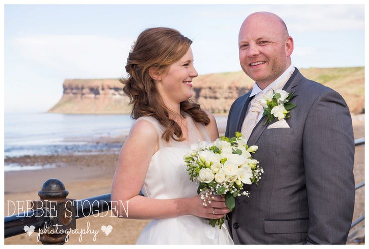 Bride and Groom with Huntcliffe in the background #Saltburn #wedding