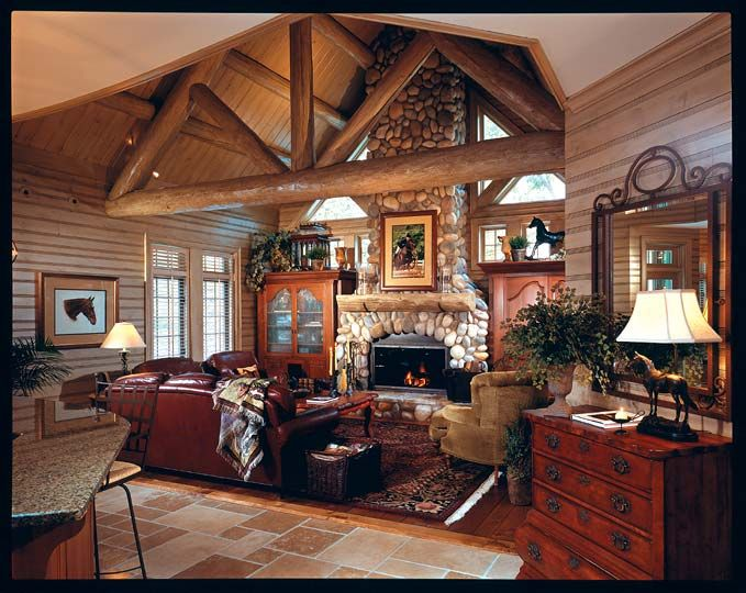 Living room with cedar log ceiling and roof support beams ...