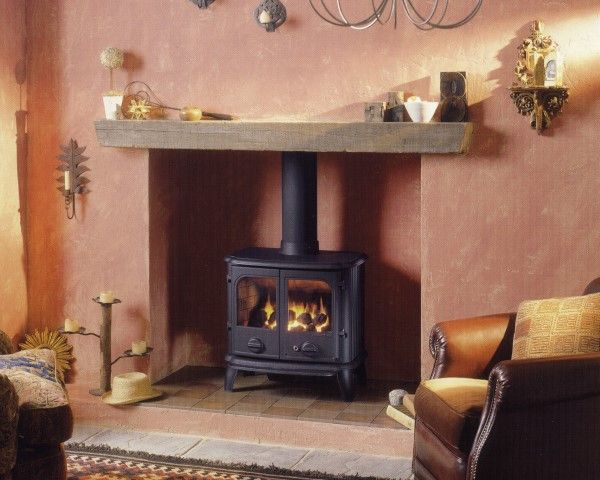 54 best ideas about woodburning stove on pinterest for Wood fireplace surround designs