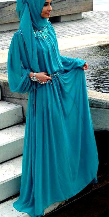 Hijab with blue abayadress - Nice, but the bracelet shes wearing shouldnt be showing :)