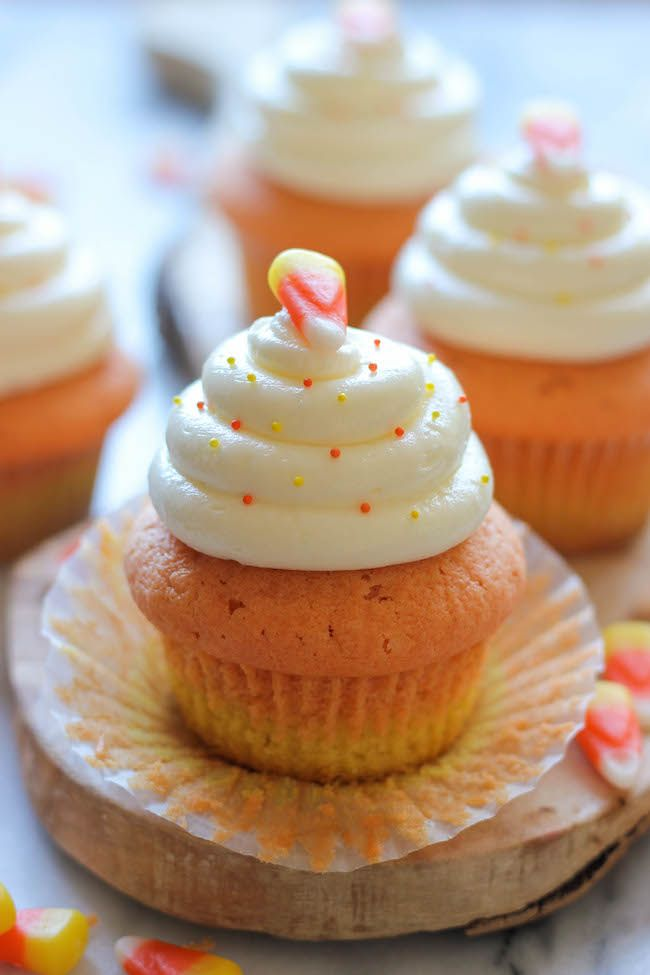 Candy Corn Cupcakes - These simple vanilla cupcakes can easily be dressed up to resemble the layers of candy corn goodness!