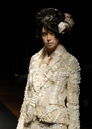 """Mr. Morinaga Kunihiko. fashion designer and artisan creator of ANREALAGE brand based in Tokyo.  Here: """"Prayer"""" 2007SS. At a glance, an overwhelming sense of force and presence hits you. The jacket, from top to bottom, is made of... buttons! There are 5000 buttons on the Prayer Jacket! 15,000 on the gold Full Metal Jacket!!"""