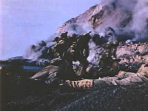 Rare color footage of U.S. Marines at Iwo Jima in February 1945 during the Second World War. Footage includes Marines in amphibious vehicles, combat on Mount Suribachi and the flag raising on Mount Suribachi. Footage courtesy of the National Archives and Records Administration (NARA).