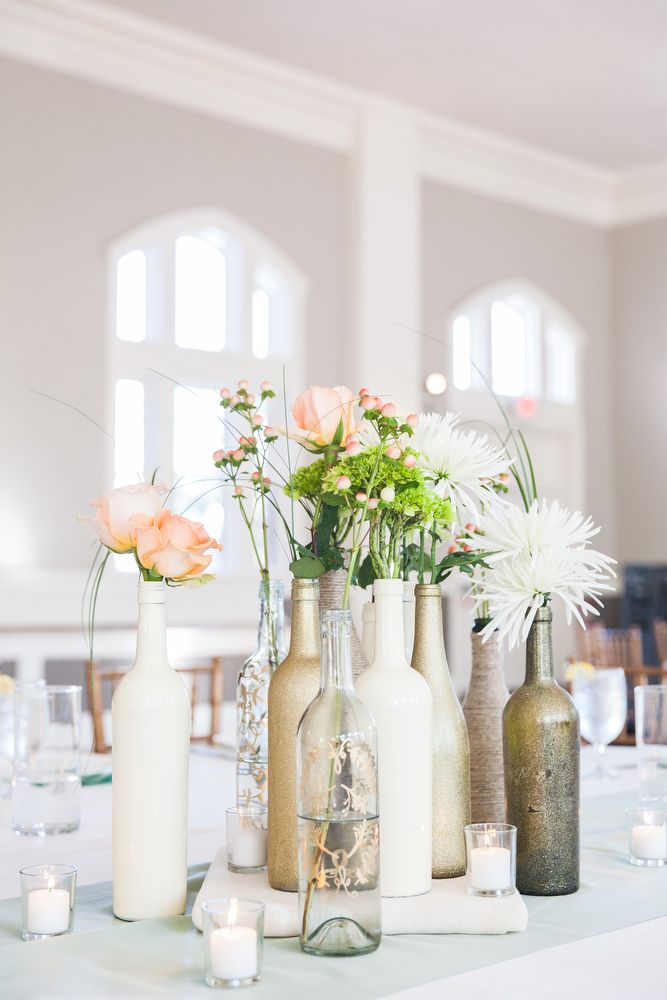 Best 25 wine bottle centerpieces ideas on pinterest for Painted wine bottle wedding centerpieces