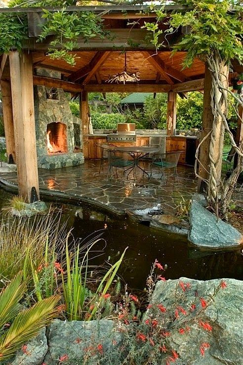 Amazing outdoor space- Pergola with fireplace and water