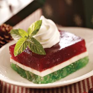 Layered Christmas Gelatin Recipe:  Christmastime always means that this recipe comes out of my recipe box. The traditional holiday colors in this salad make the holiday table look so pretty.