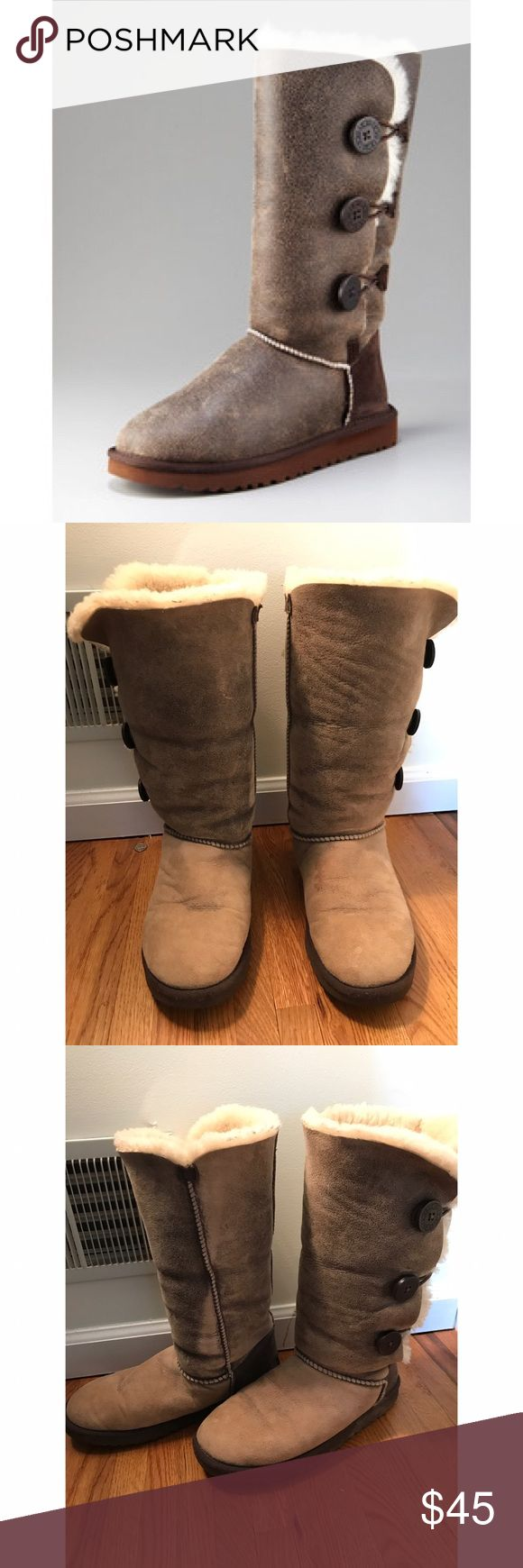 """Bailey Button Bomber Ugg Boots 17mm grade """"A"""" Twinface sheepskin. Styles in this collection are designed with an elastic closure and functional wood button that has been laser-etched with our original UGG logo. There is a small rip in the fur on the inside, but this is not noticeable when wearing them (this is why they aren't expensive). Thanks! UGG Shoes Winter & Rain Boots"""