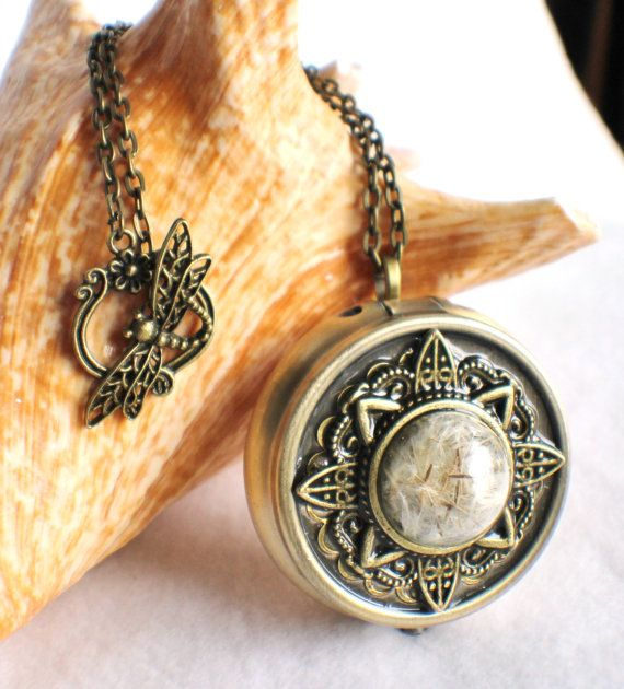 Music box locket,  round locket with music box inside, in bronze with dandelion wishes encased in glass