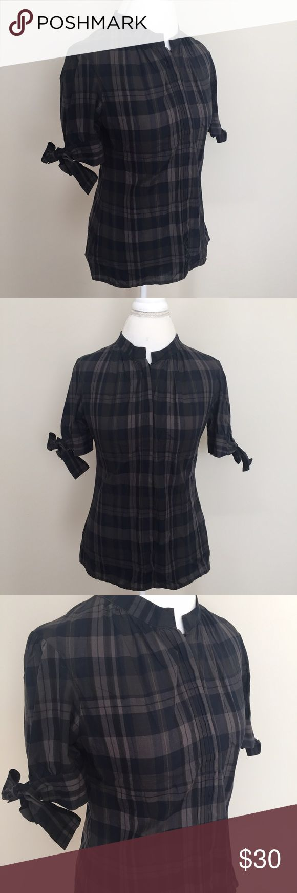 Ted Baker London Plaid High Collar Pleated Shirt Ted Baker London Plaid button front shirt (hidden front button placket) with high collar style, Pleated detail at front, and ties at sleeves. Size Ted 3, which equals a US size 8 or medium. Excellent condition with no flaws. ⚓️No trades or holds. I accept reasonable offers. I only negotiate through the offer button. I do not model. I ship within two business days of your order. I only use Posh. 🚭🐩B5 Ted Baker Tops Button Down Shirts