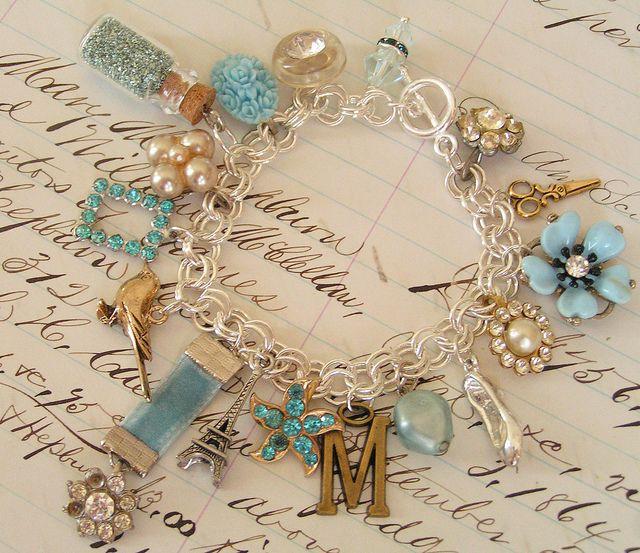 Beautiful charm bracelet made with vintage trinkets!!