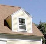 A dormer is a window that is set vertically on a sloping roof. The dormer has its own roof, which may be flat, arched, or pointed.    The dormer shown here has a gable roof.