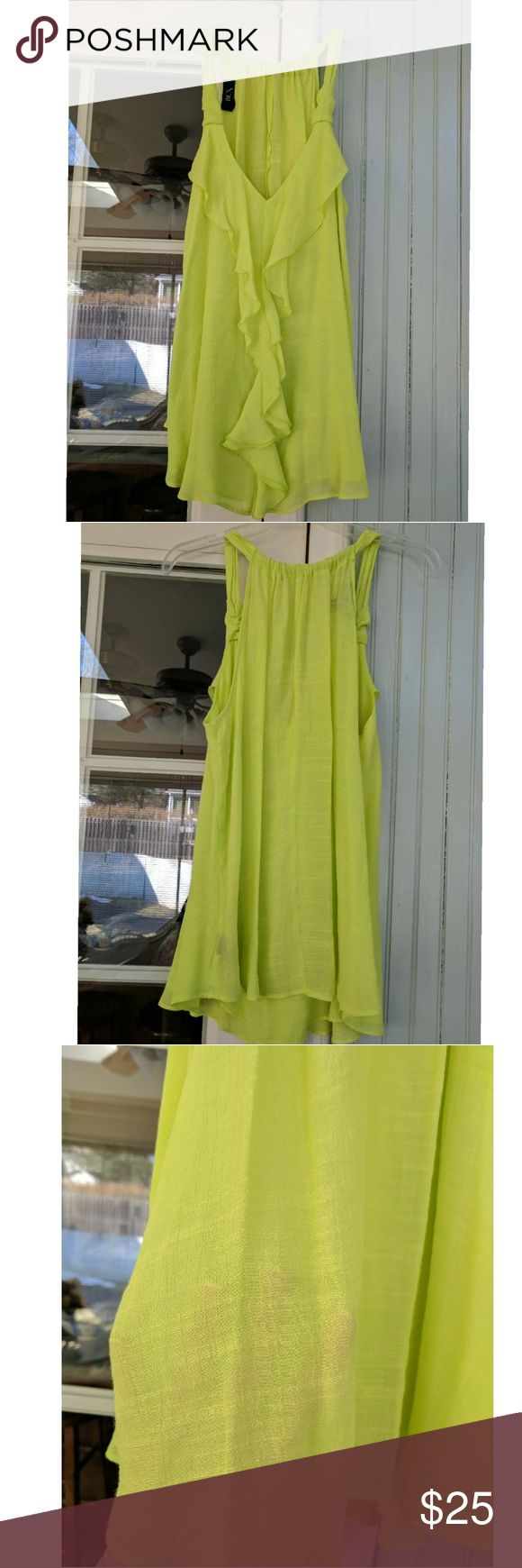 Sleeveless Ruffle Shirt Neon Yellow/Green cascading ruffle front tank by a company called BCX.  Rayon Polyester Blend. Size XL. Lined Front. Single layer back slightly transparent. Top of back has adjustable width- fabric can be sprunched or pulled apart along the straps. Like new. Worn once. BCX Tops Tank Tops
