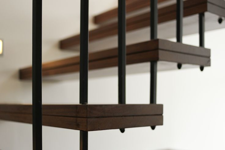 Detail of metal balustrading and floating timber staircase