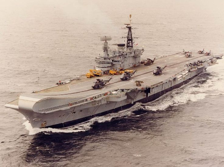 The Falklands War between the U.K. and Argentina begins and ends. (Apr-Jun 1982) Photo: HMS Hermes, flagship for the Royal Navy during the Falklands War.