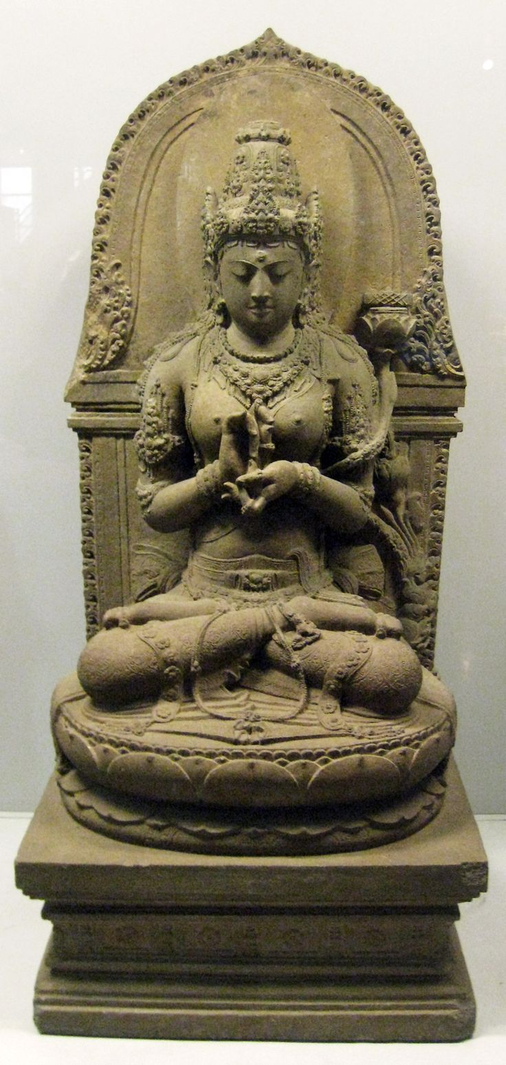 Bodhisattvadevi (female bodhisattva) Prajnaparamita; the buddhist goddess of transcendental wisdom, personified in a statue from 13th century Singhasari East Javanese art. The statue was discovered in Cungkup Putri ruins near Singhasari temple, Singhasari, East Java.