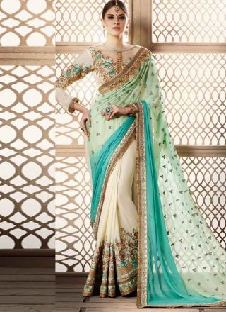Dazzling Turquoise Off White Embroidery Work Georgette Silk Wedding Sarees   #Sarees #Designer  http://www.angelnx.com/Sarees