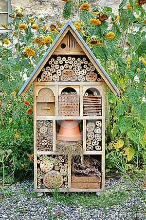a garden home for beneficial insects! Craftsman Built Insect Hotel Decorative Wood House by Olivier Le Queinec, via Dreamstime