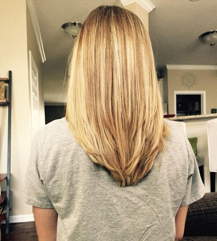 V shape in the back with some long layers! My new hair style. Very good for my thick hair.