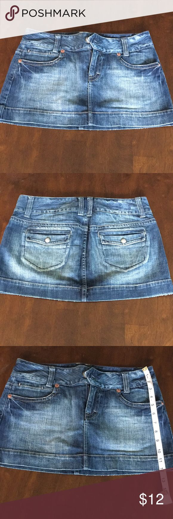 American Eagle Dark wash jean skirt EUC. Can't even remember wearing this beauty!! Great wash. Love love love the waist band!! Please see photos for measurements. American Eagle Outfitters Skirts Mini