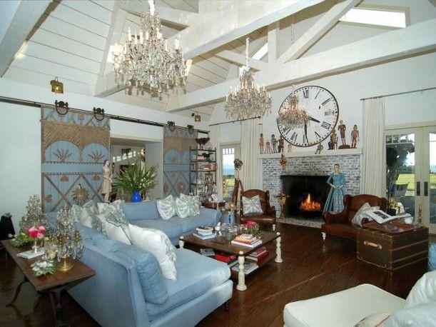 blue family room of Sharon Osburne by Hooked on Houses.  Love the sliding barn doors