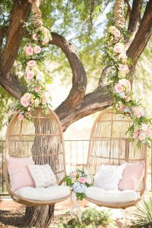 Floral adorned hanging sweetheart chairs: http://www.stylemepretty.com/arizona-weddings/paradise-valley/2015/08/26/rustic-romantic-arizona-summer-wedding/ | Photography: Amy & Jordan - http://amyandjordan.com/