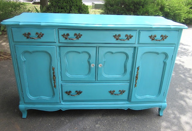 love this french sideboard from uniquely chic!  love the two little center doors- so cute!  and turquoise!