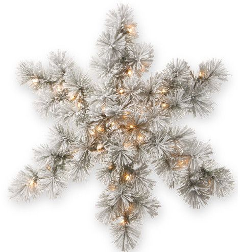 Snowy Bristol pine snowflake with lights . I love all these pine snowflakes I've been seeing this year! Super festive but also a very natural, rustic vibe...