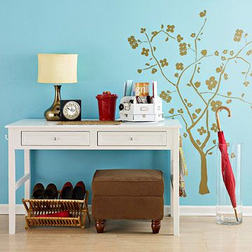 Tight-Space Entryway Storage- This small desk makes a space-saving entryway organizer. Place mail, keys, cell phones, and other small items in an organizer on top of the desk. A recycled dish drying rack makes room for three pairs of shoes to air dry. Attach cute hooks to the side of the desk to hold purses, leashes, and backpacks. An oversize glass vase makes a chic umbrella stand.